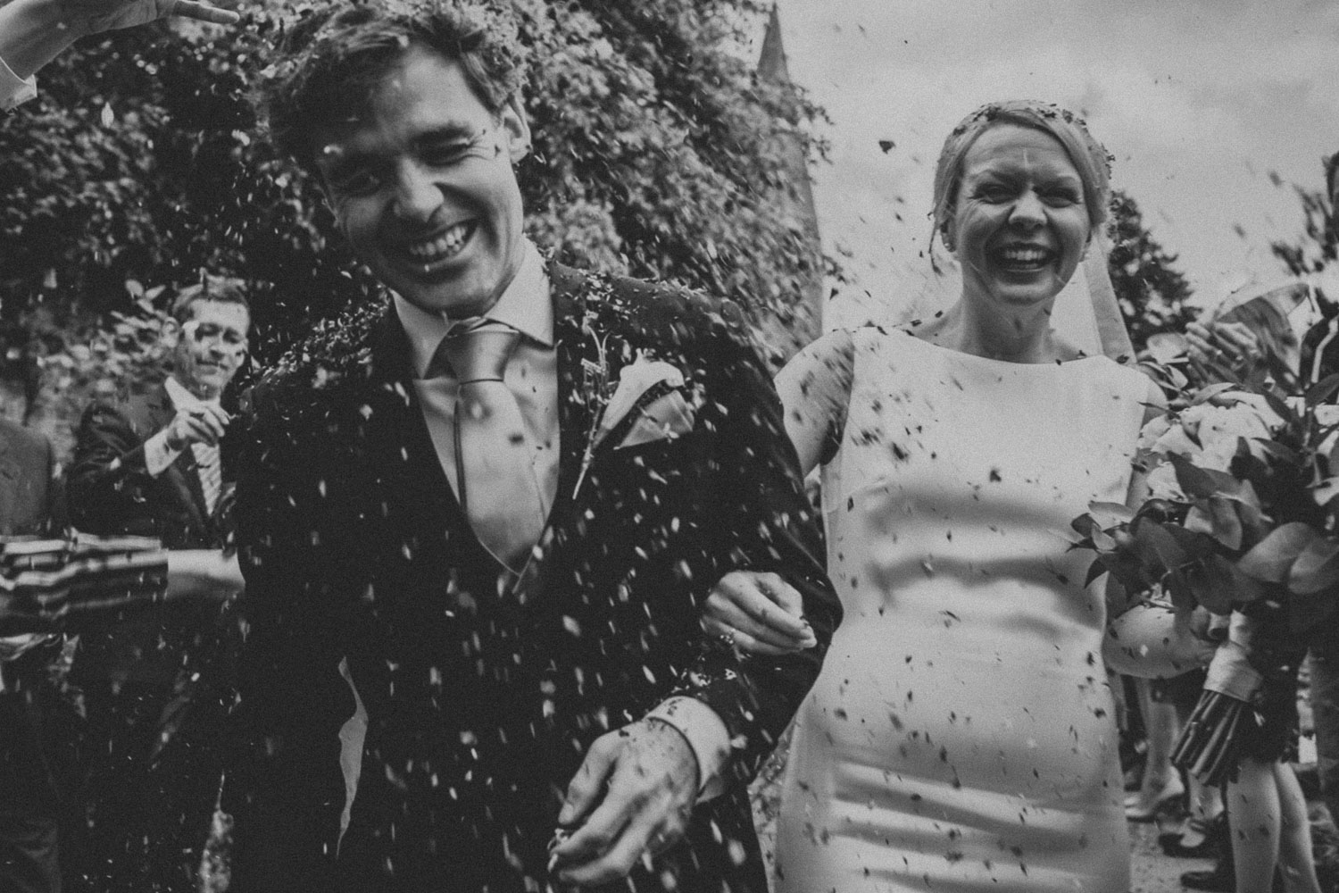 Booking a wedding venue couple confetti throw
